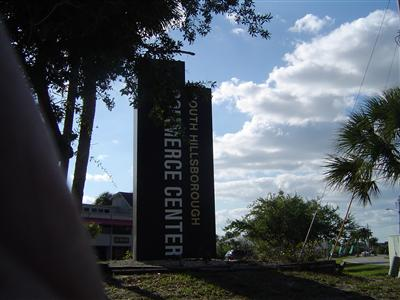 sign of the industral park of building of Bayside we Insure Florida